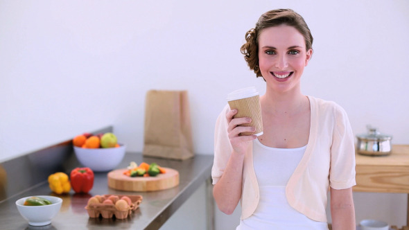 Pretty Model Standing In Kitchen Drinking Coffee 2