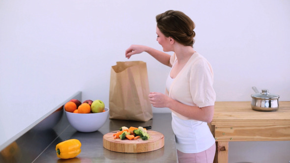 Pretty Model Standing In Kitchen With Peppers 2