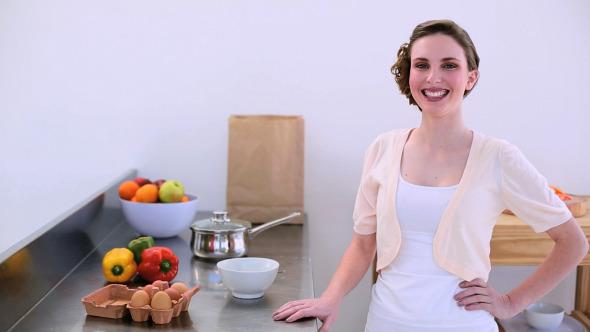 Pretty Model Standing In Kitchen Preparing Eggs