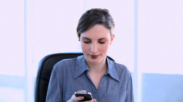 Happy Businesswoman Answering Smartphone