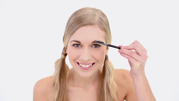 VideoHive Happy Nude Blonde Using Eyebrow Brush 8358275