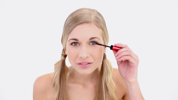 VideoHive Happy Nude Blonde Applying Mascara 8358292