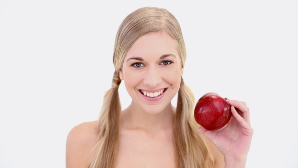 VideoHive Happy Nude Blonde Holding Red Apple 8358364