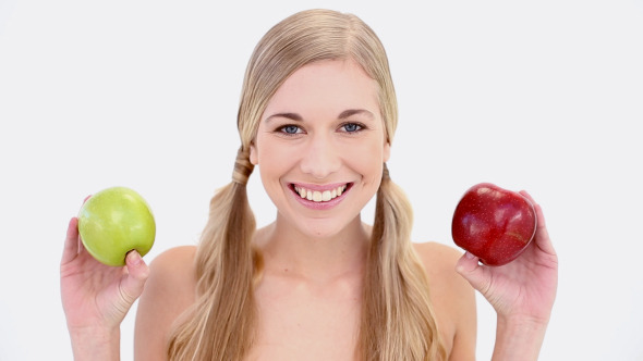 Happy Nude Blonde Holding Red And Green Apples