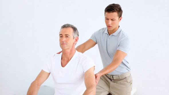Physiotherapist Checking Senior Patient Stretching 1