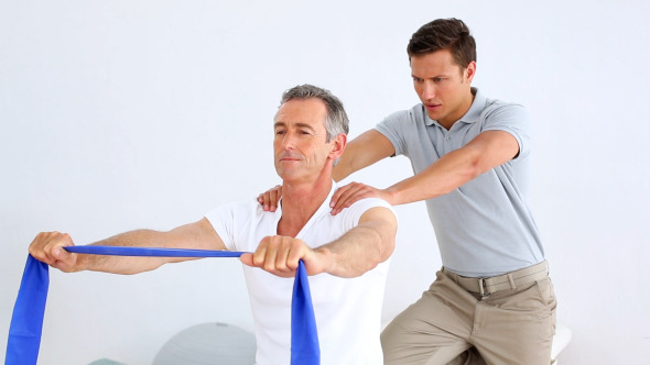 Physiotherapist Checking Senior Patient Stretching 2