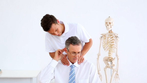 Physiotherapist Giving Businessman A Massage
