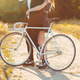 Young stylish guy with girl and the bicycle outdoors - PhotoDune Item for Sale