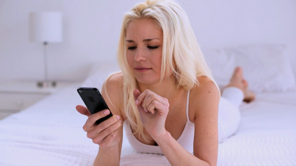 Cute Natural Woman Messaging With Her Smartphone
