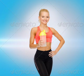 smiling sporty woman with protein shake bottle - PhotoDune Item for Sale