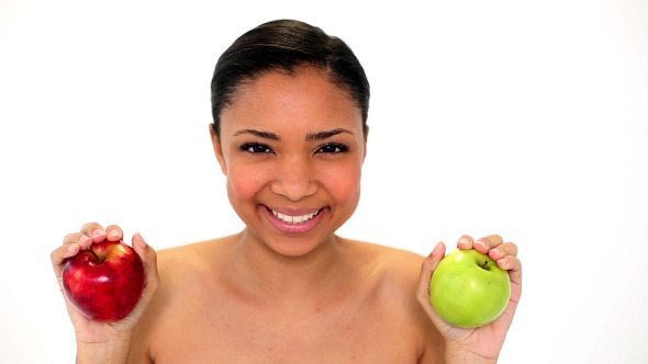 Beautiful Young Woman Holding Two Apples