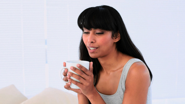 Attractive Woman Enjoying Her Morning Coffee