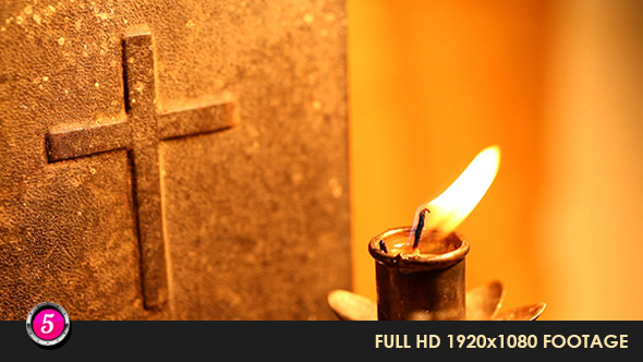 Candle With Holy Cross In Background