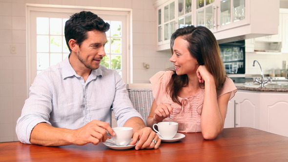 Happy Couple Drinking Coffee Together 1
