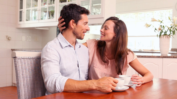 Happy Couple Drinking Coffee Together 2