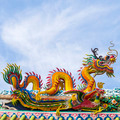 Chinese dragon on blue sky with cloud top of temple - PhotoDune Item for Sale
