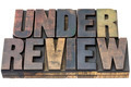 under review in wood type - PhotoDune Item for Sale