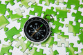 compass on the green puzzle - PhotoDune Item for Sale