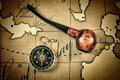 tobacco pipe and compass on map - PhotoDune Item for Sale