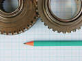 Gear and pencil on graph paper - PhotoDune Item for Sale