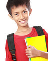 Portrait of boy with backpack smiling - PhotoDune Item for Sale