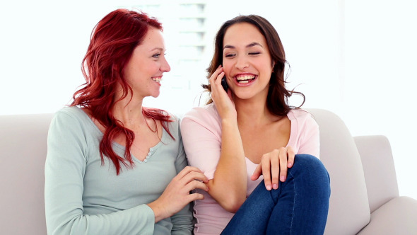 Lovely Happy Women Phoning Excited With Smartphone