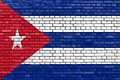 flag of Cuba painted on brick wall - PhotoDune Item for Sale