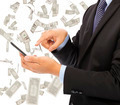 business man touching smart phone with money rain - PhotoDune Item for Sale