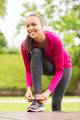 smiling woman exercising outdoors - PhotoDune Item for Sale
