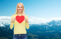 smiling woman with red heart - PhotoDune Item for Sale