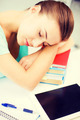 tired student sleeping on stock of books - PhotoDune Item for Sale