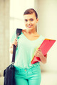 student girl with school bag and color folders - PhotoDune Item for Sale