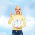student with wall clock and finger up - PhotoDune Item for Sale