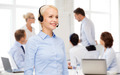 friendly female helpline operator with headphones - PhotoDune Item for Sale