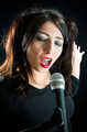 Woman Singing With Microphone - PhotoDune Item for Sale