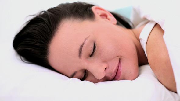 Calm Beautiful Woman Lying In Her Bed