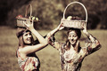 Happy young girls with a fruit basket on nature  - PhotoDune Item for Sale