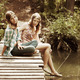Young girls on the wooden bridge - PhotoDune Item for Sale