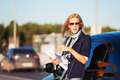 Fashion business woman with financial papers at the car  - PhotoDune Item for Sale