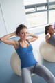 Women training on exercise ball in  gym