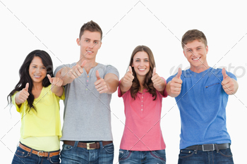 A smiling group of friends give a thumbs up while looking at the camera - PhotoDune Item for Sale