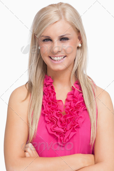 Smiling blonde arms crossed against white background - PhotoDune Item for Sale
