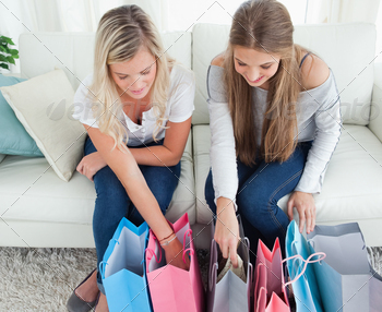 Girls with bags of shopping as they look into them - PhotoDune Item for Sale