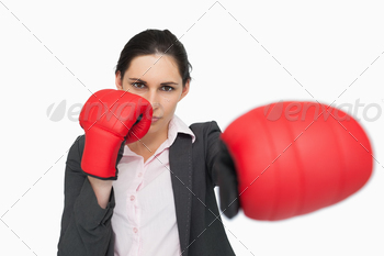 Serious woman wearing red gloves punching against white background - PhotoDune Item for Sale