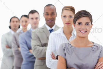 Close-up of a business team in a single line crossing their arms with focus on the first woman - PhotoDune Item for Sale