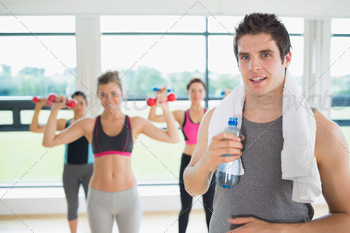 Man taking break from aerobics class with water and towel - PhotoDune Item for Sale