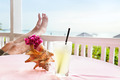 By the Ocean, feet up with a drink - PhotoDune Item for Sale