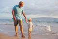 Father and son wallking on the beach - PhotoDune Item for Sale