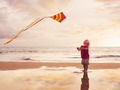 Young boy playing with kite - PhotoDune Item for Sale