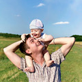 father holds a small child on his shoulders - PhotoDune Item for Sale
